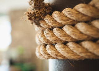 selective focus photography of brown rope