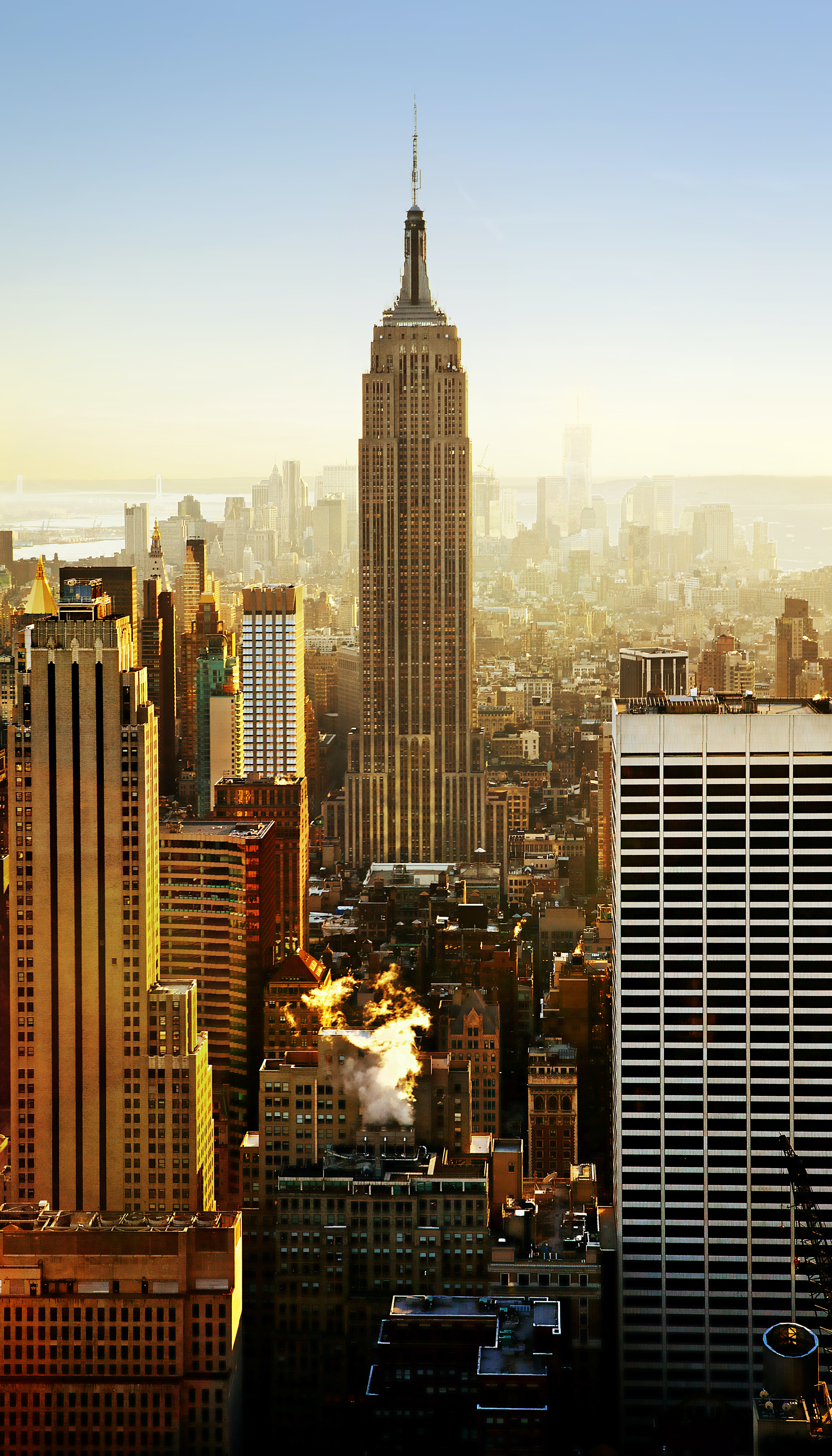 View of the Empire State Building between skyscrapers in the New York City skyline