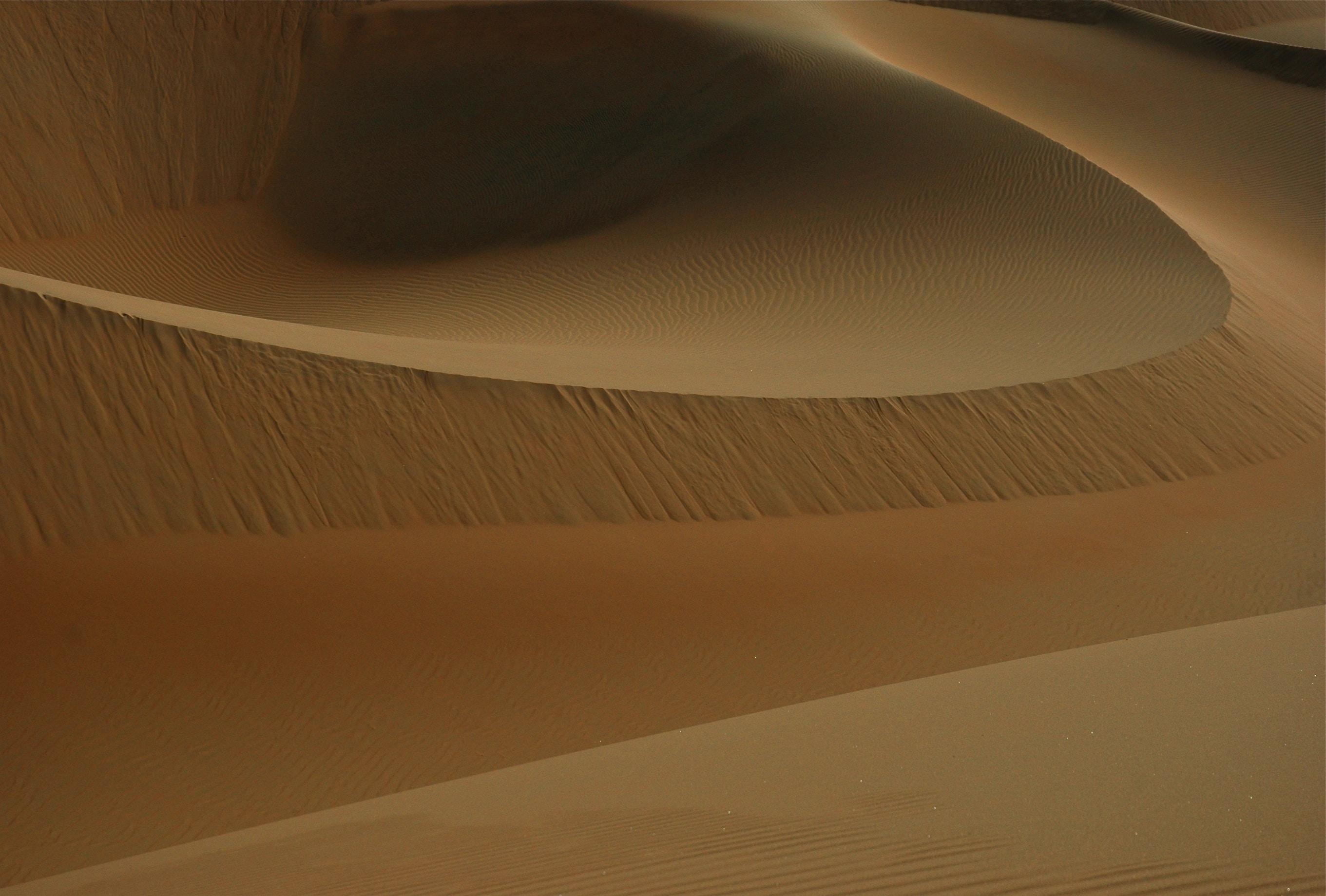 Artistic sand dunes in the desert of United Arab Emirates