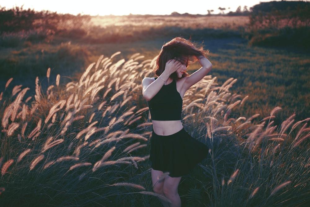 woman dancing on grass field
