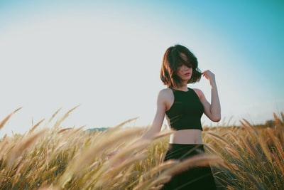 woman on wheat field during daytime girl zoom background