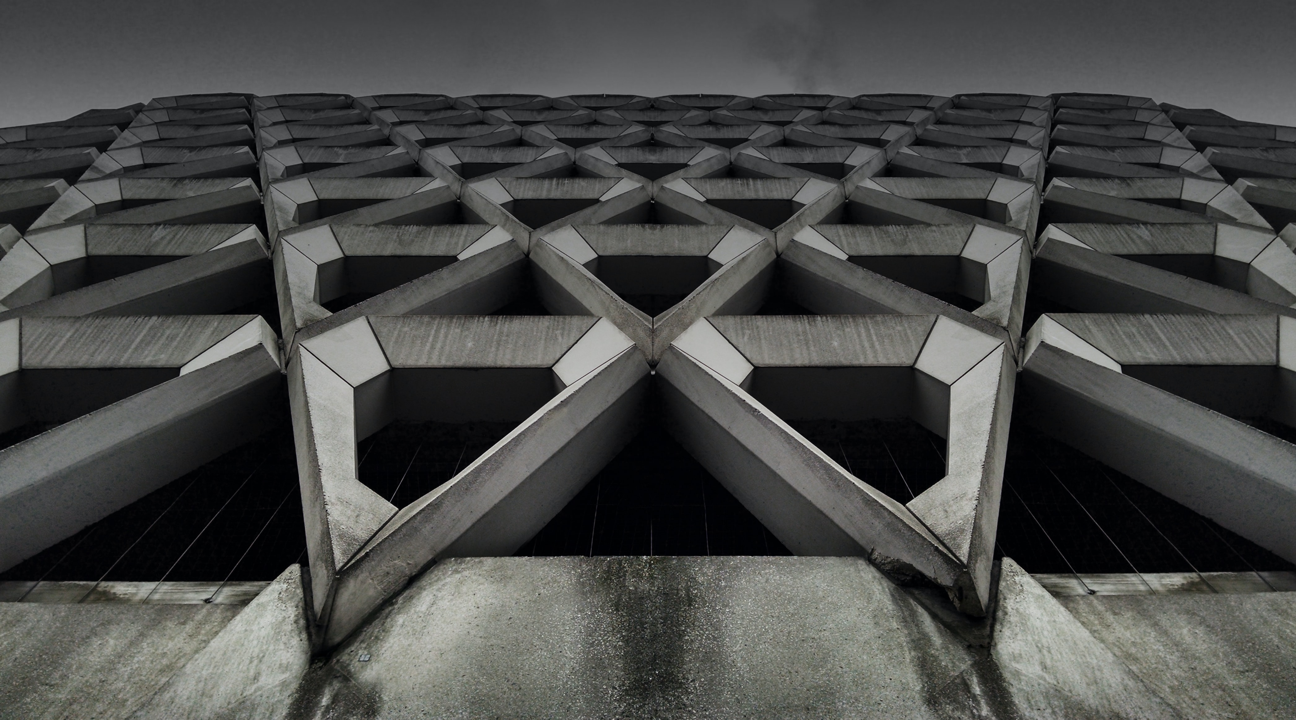 gray concrete building low-angle photography