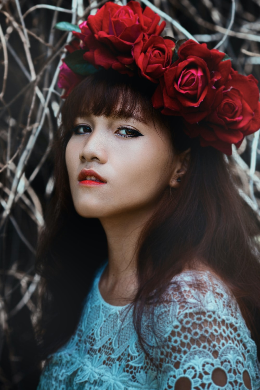 woman wearing red flower crown