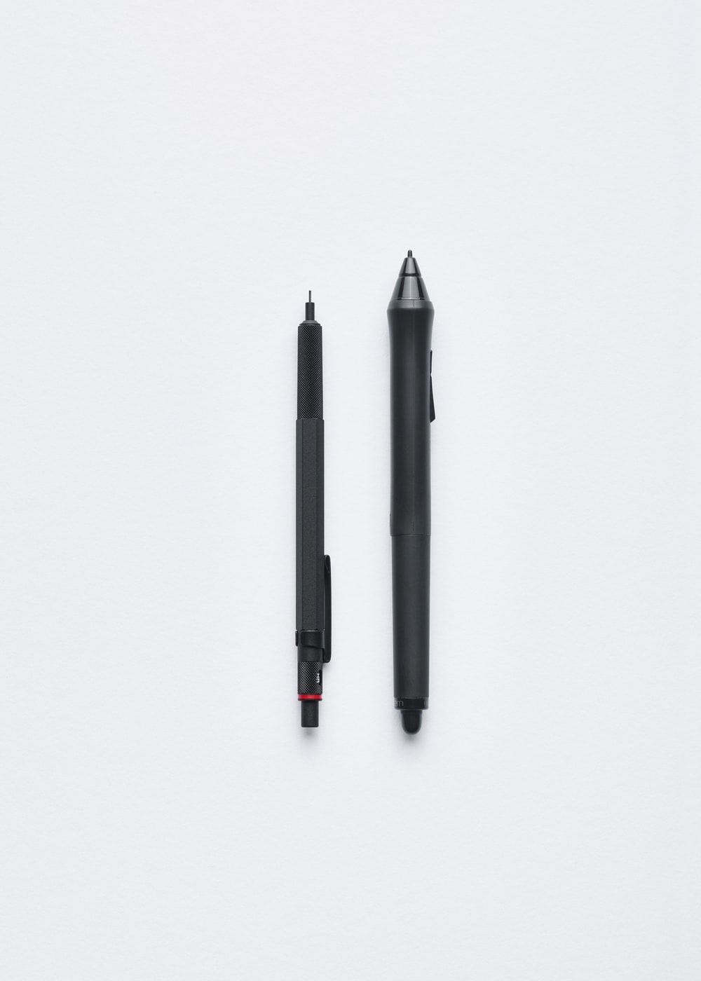 A mechanical pencil and a pen.