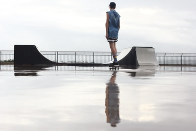 man standing on skateboard near ramp
