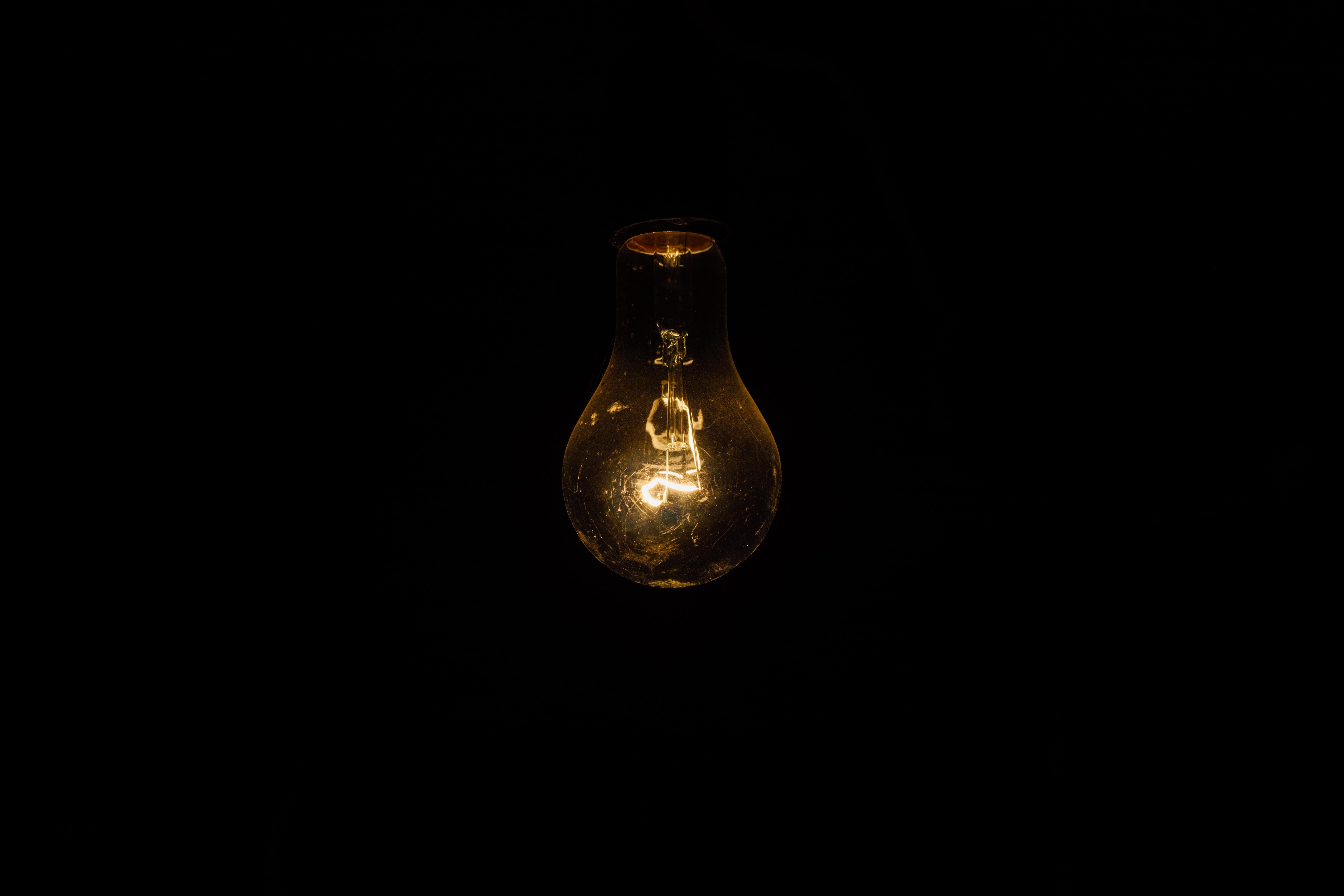 closeup photo of lighted bulb