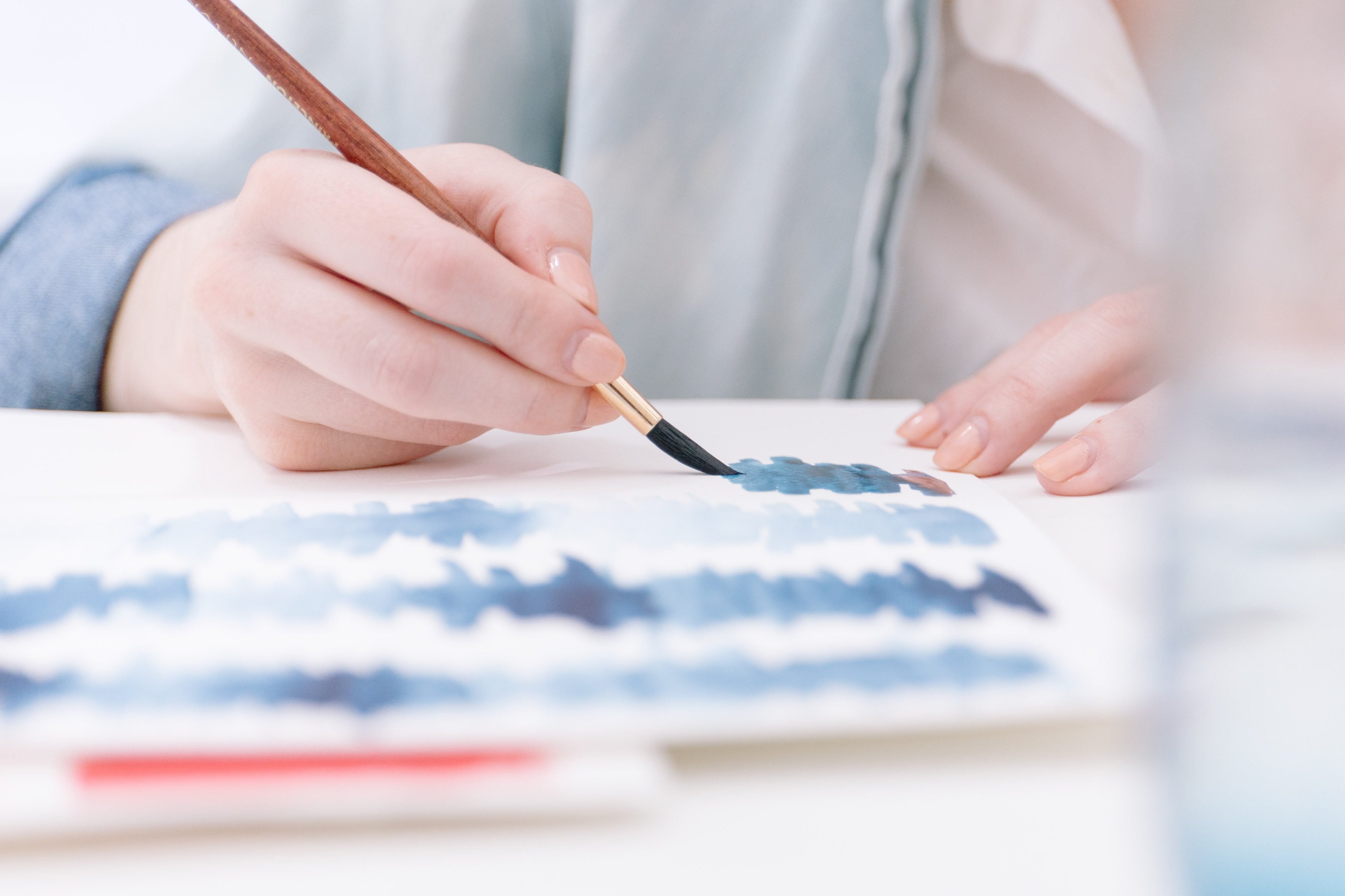 A person painting in watercolor