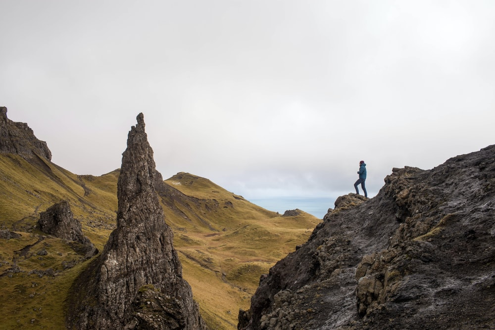 person standing on top of rock formation