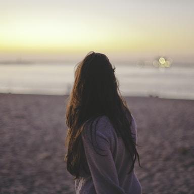 woman wearing sweater on shore