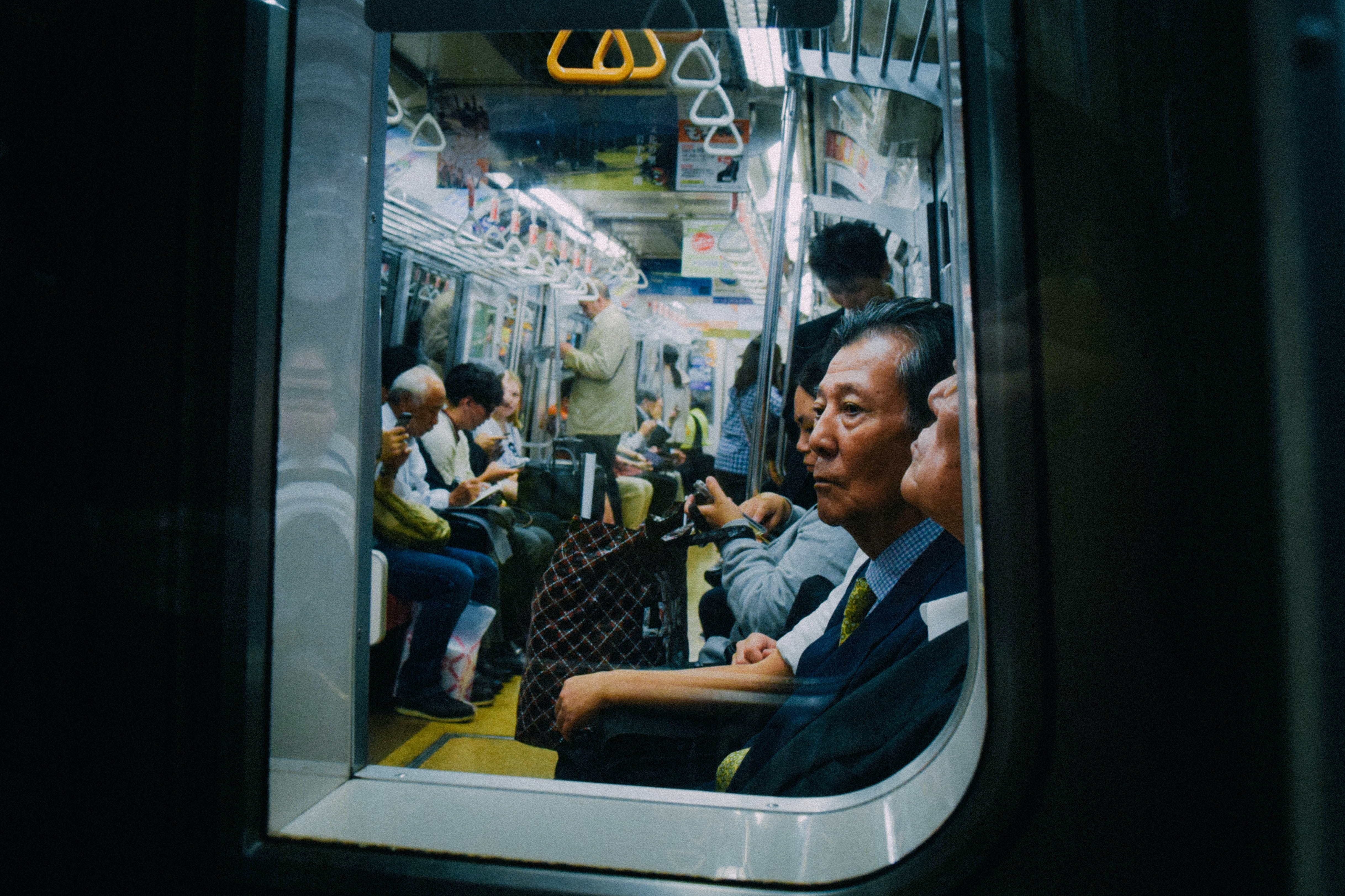 A subway car with passengers.
