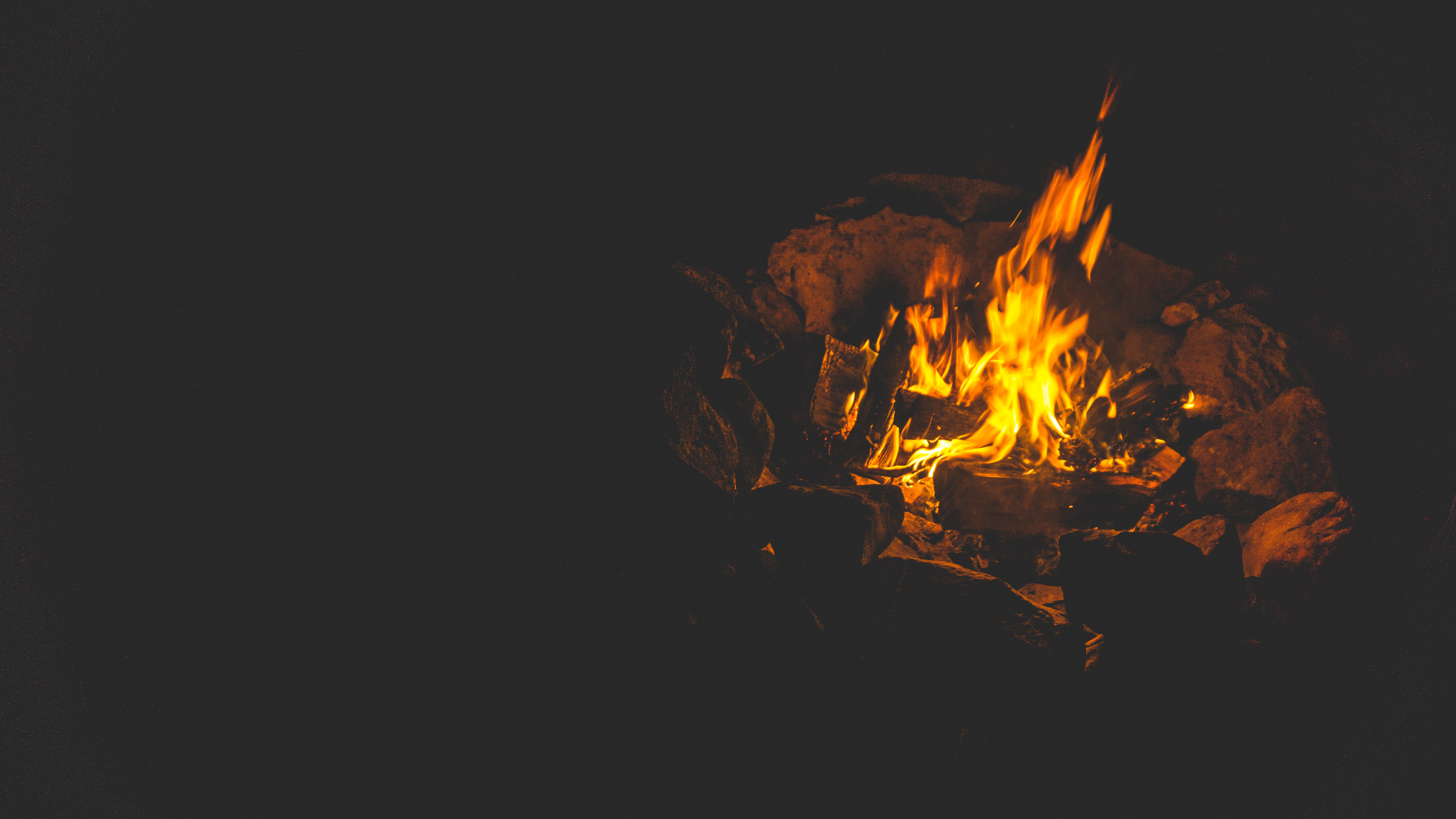 bonfire surrounded by rocks