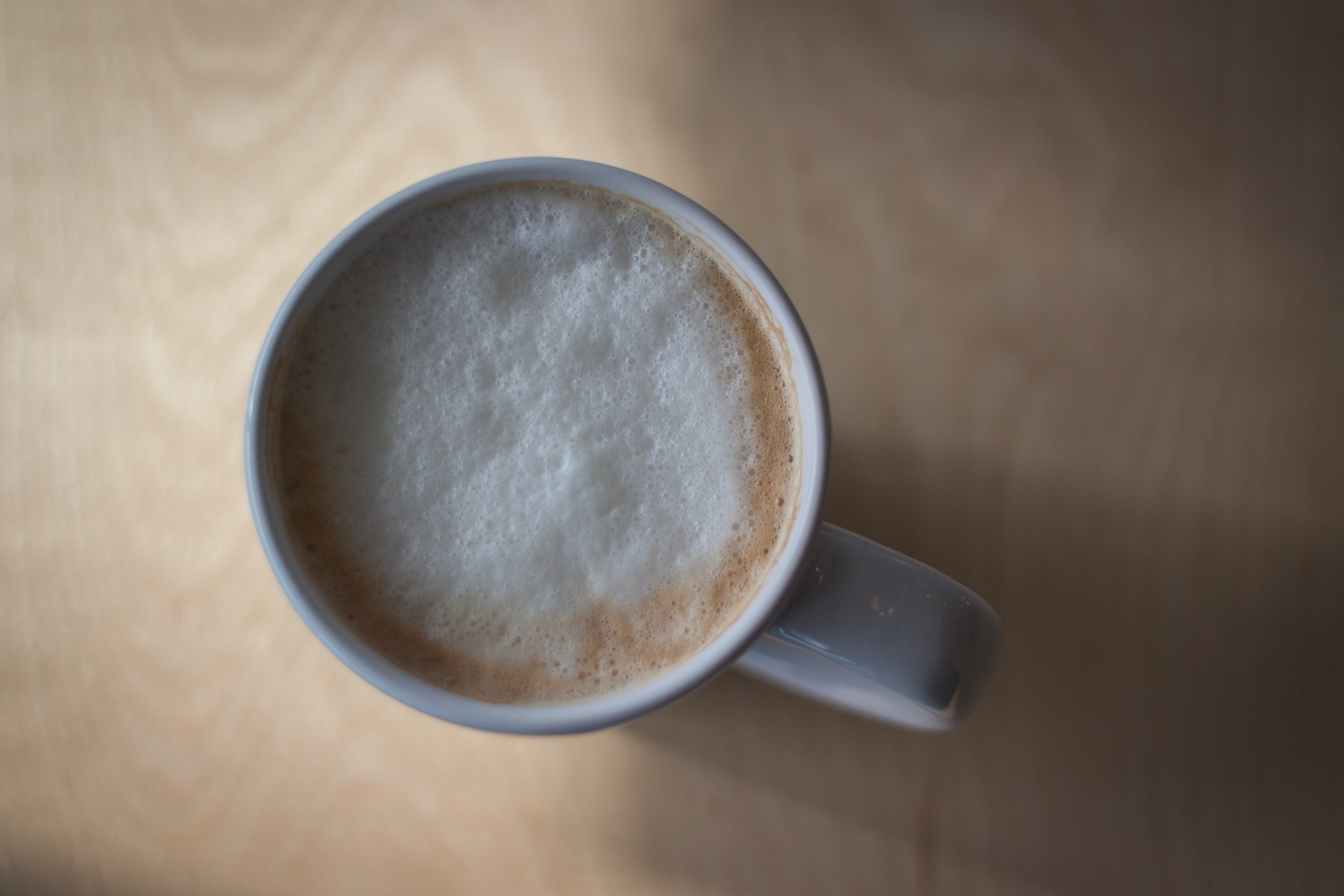 A frothy cup of coffee in a white mug in Portsmouth
