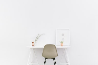 white wooden table near brown chair workspace teams background
