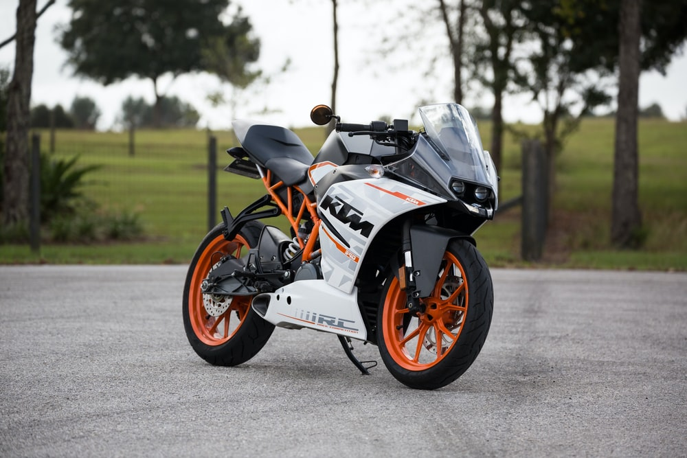 white and orange KTM sports bike selective focus photography