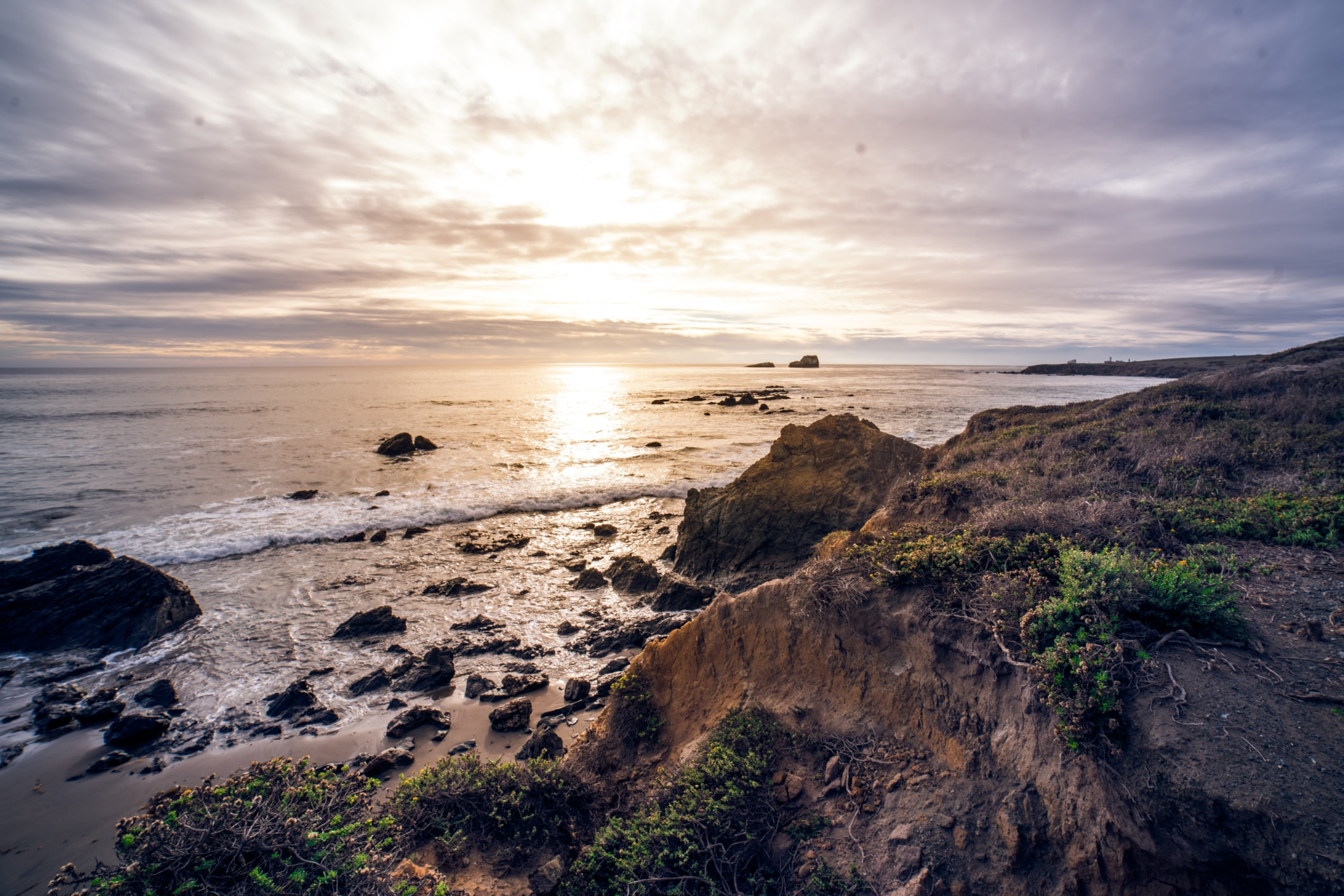 Sunset from a hill on a sandy shoreline in California