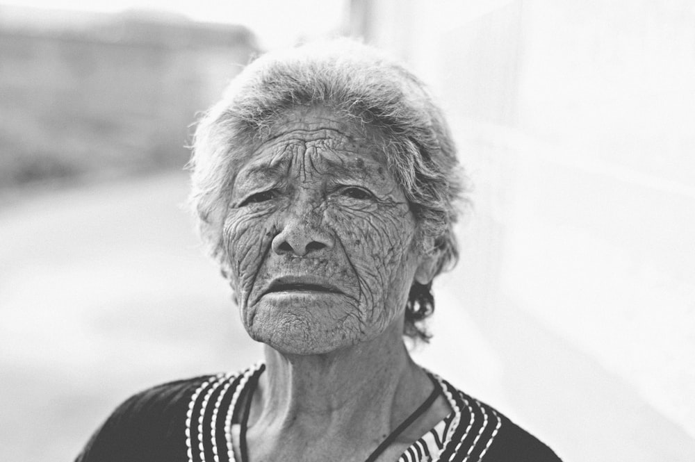 An older Asian woman looking at the camera.