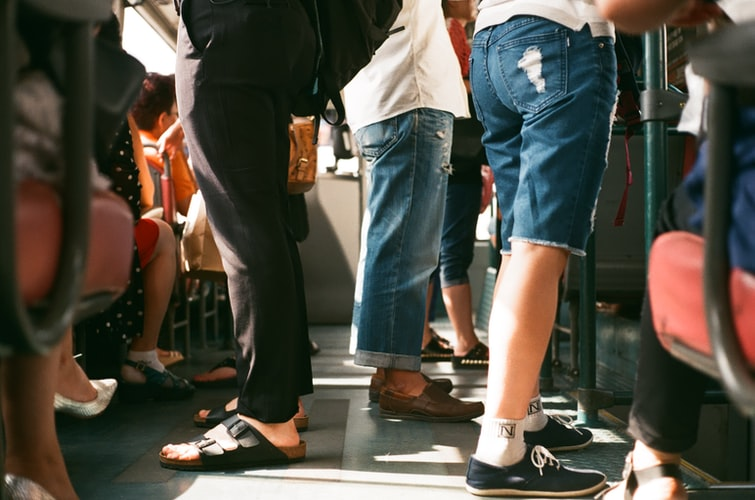 sustainable travel - people standing in public transport