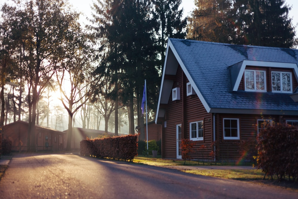 brown and red house near trees