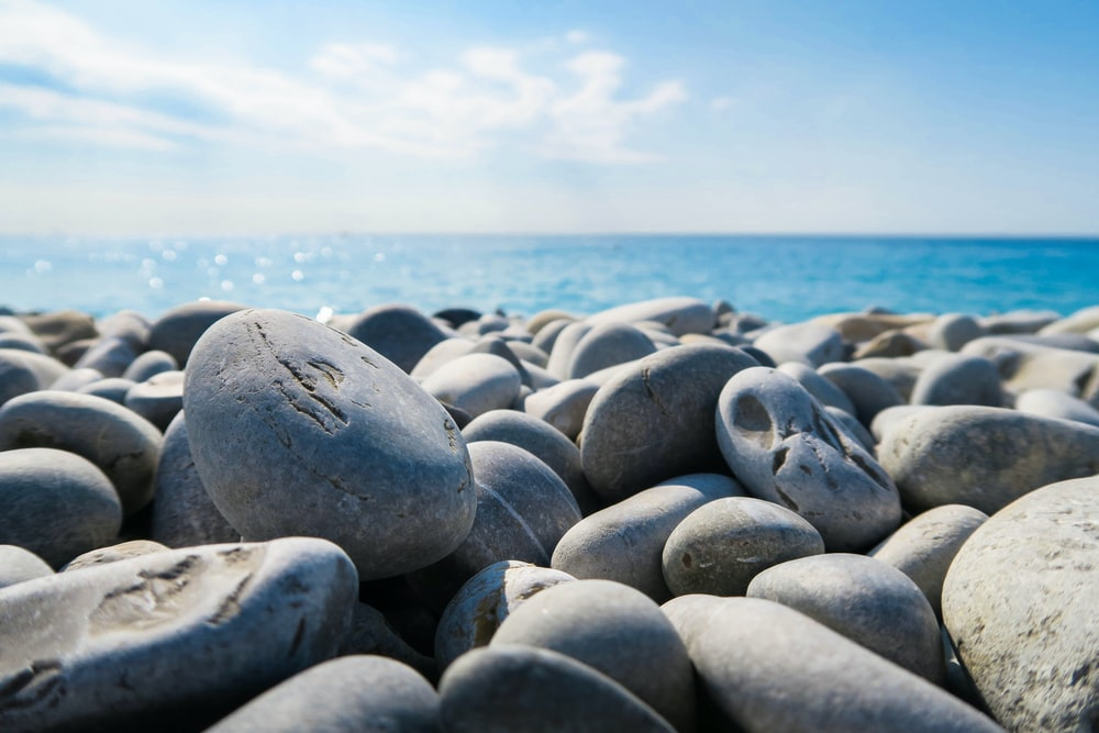 rocky shore under blue sky at daytime