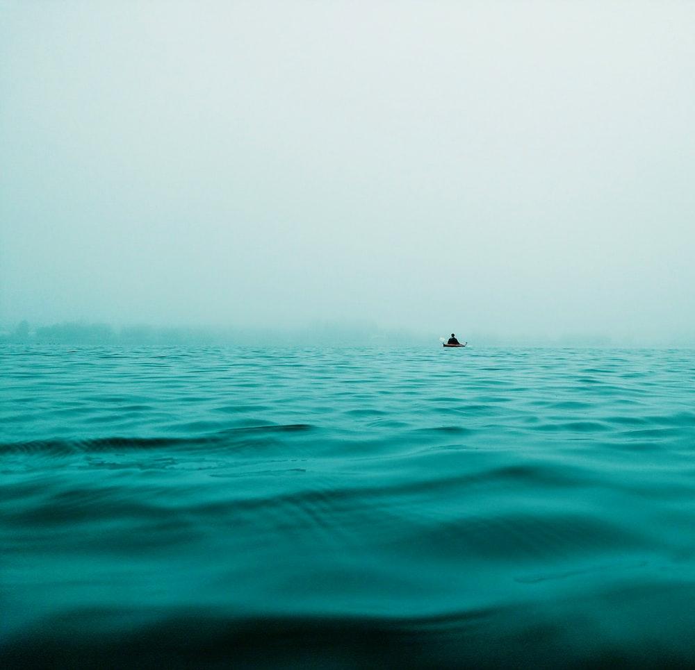 closeup photo of calm body of water