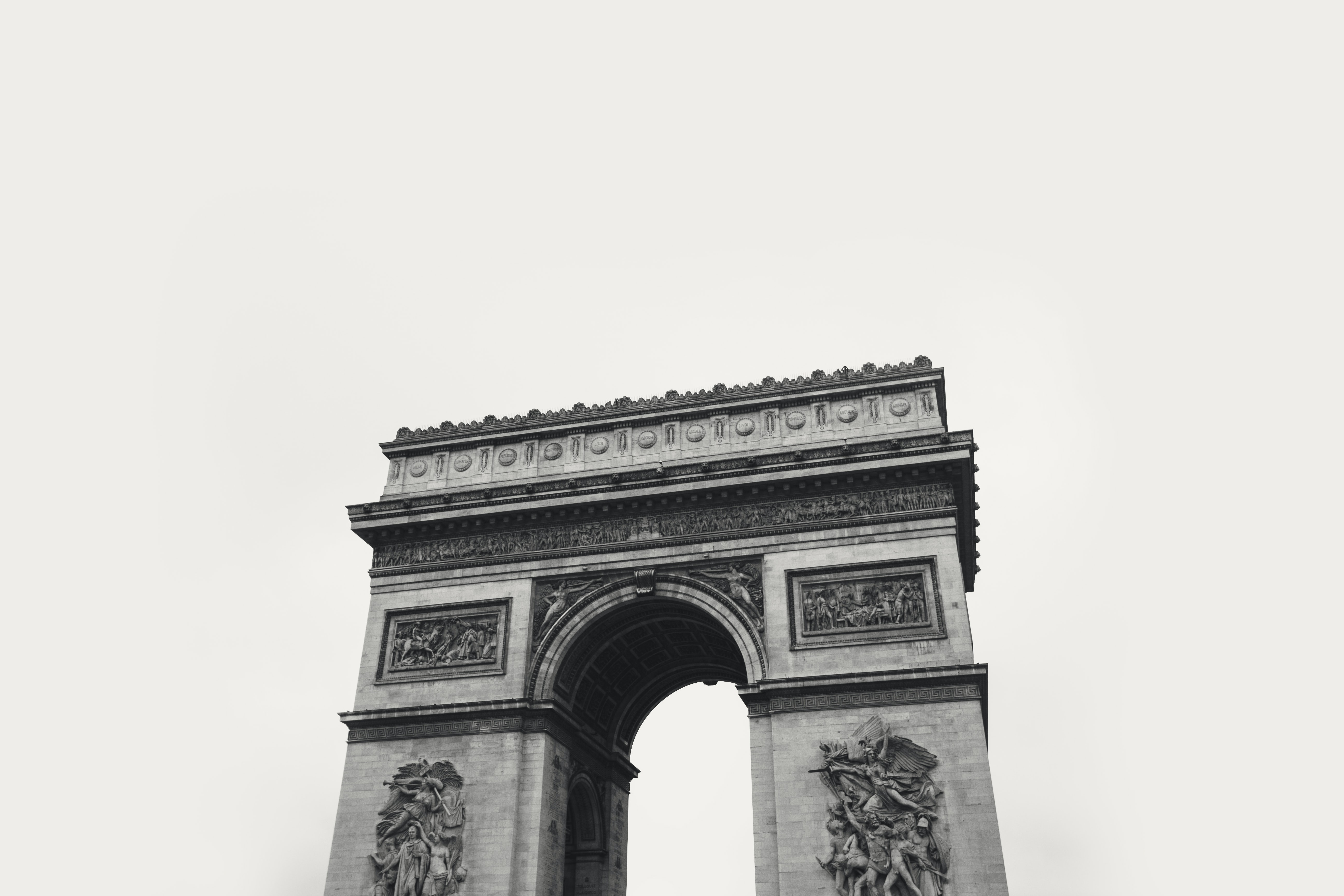 The historic French landmark the Arc de Triomphe in black and white.