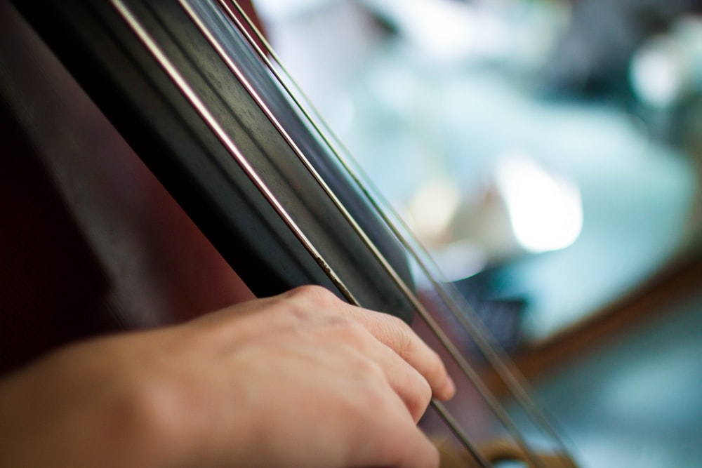 A close-up of a person playing a string instrument