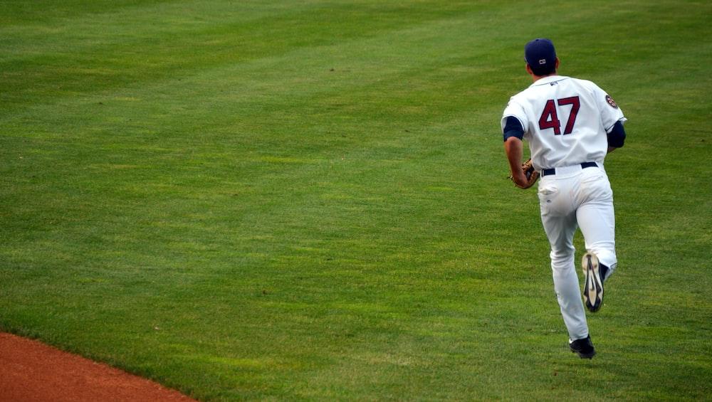 baseball player 47 running in field