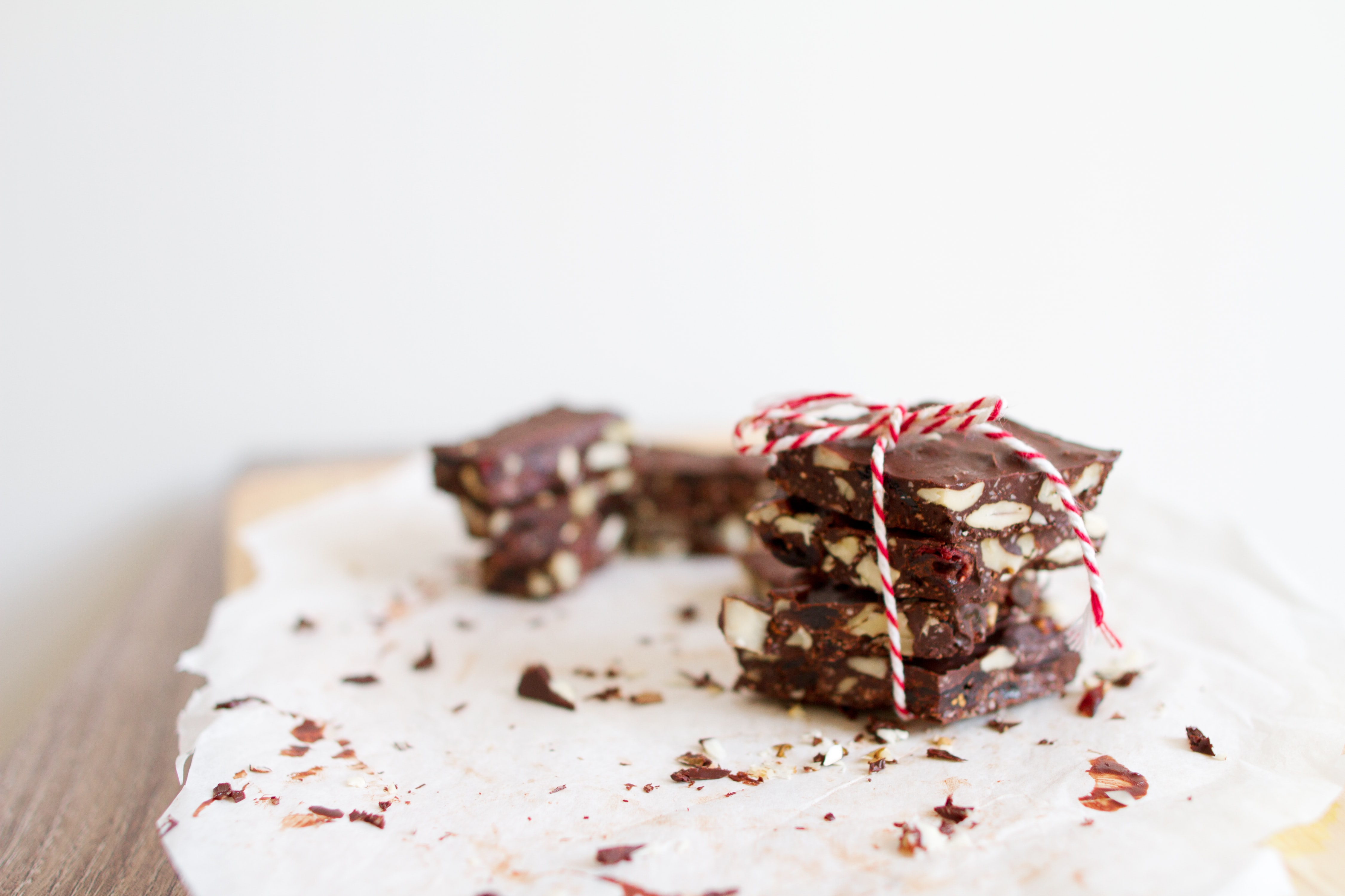 Peppermint, nut, chocolate bark tied together with red and white bakers twine
