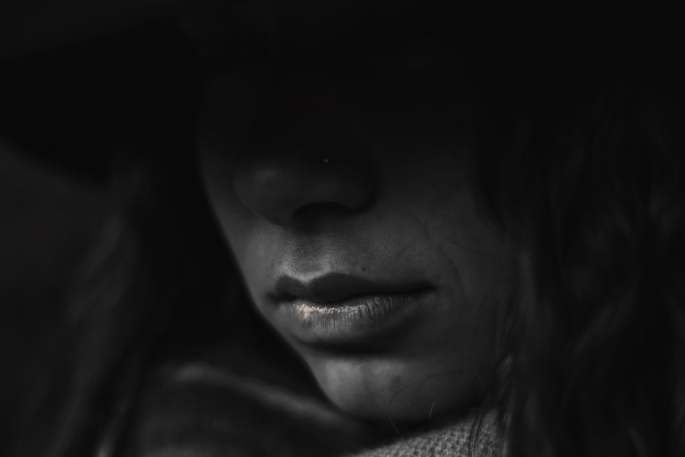 grayscale photo of person's lips