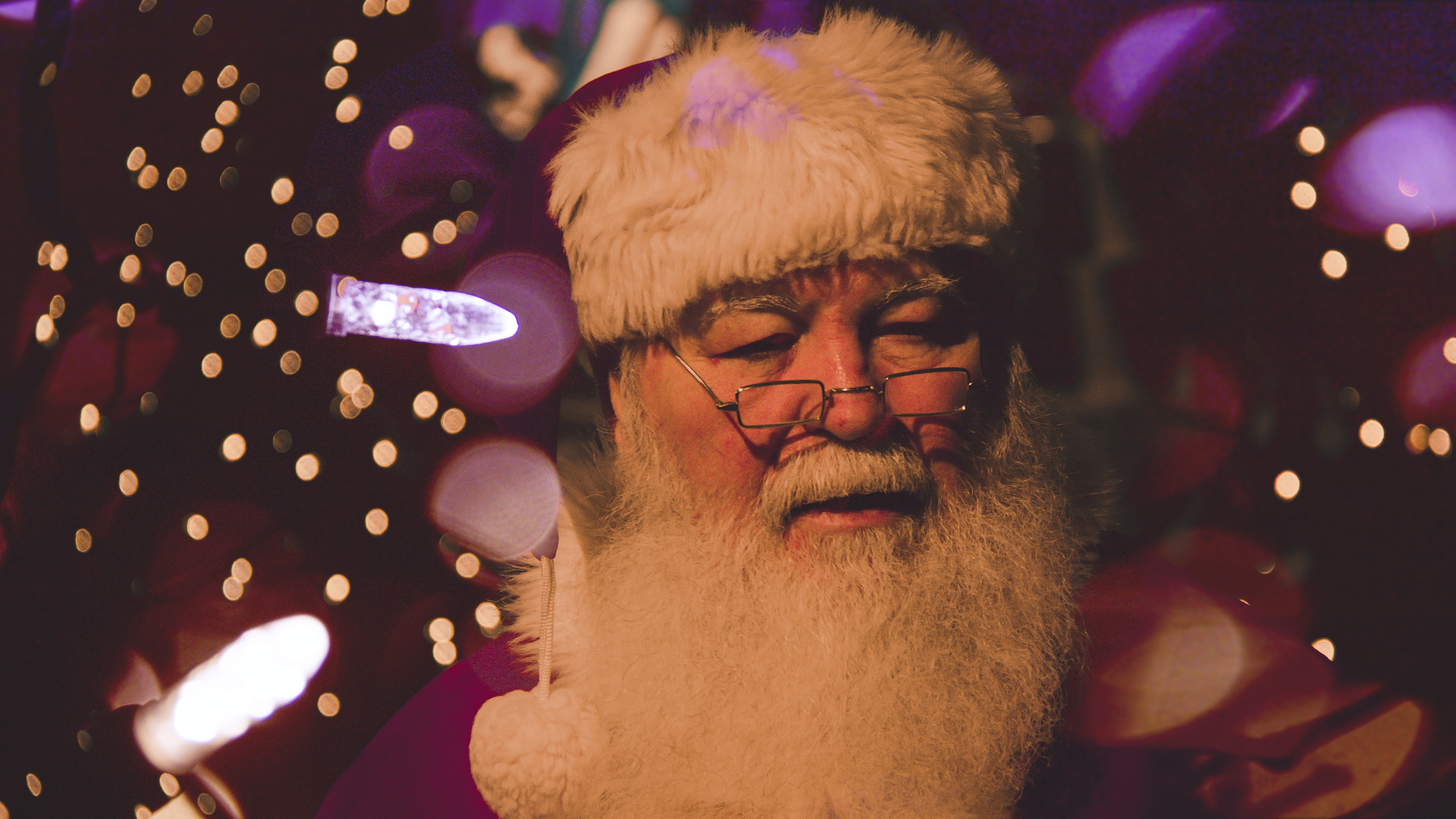 bokeh photography of Santa Claus