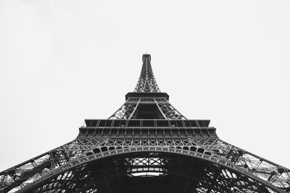 The Landmark Eiffel Tower In Paris France With A Gray Background