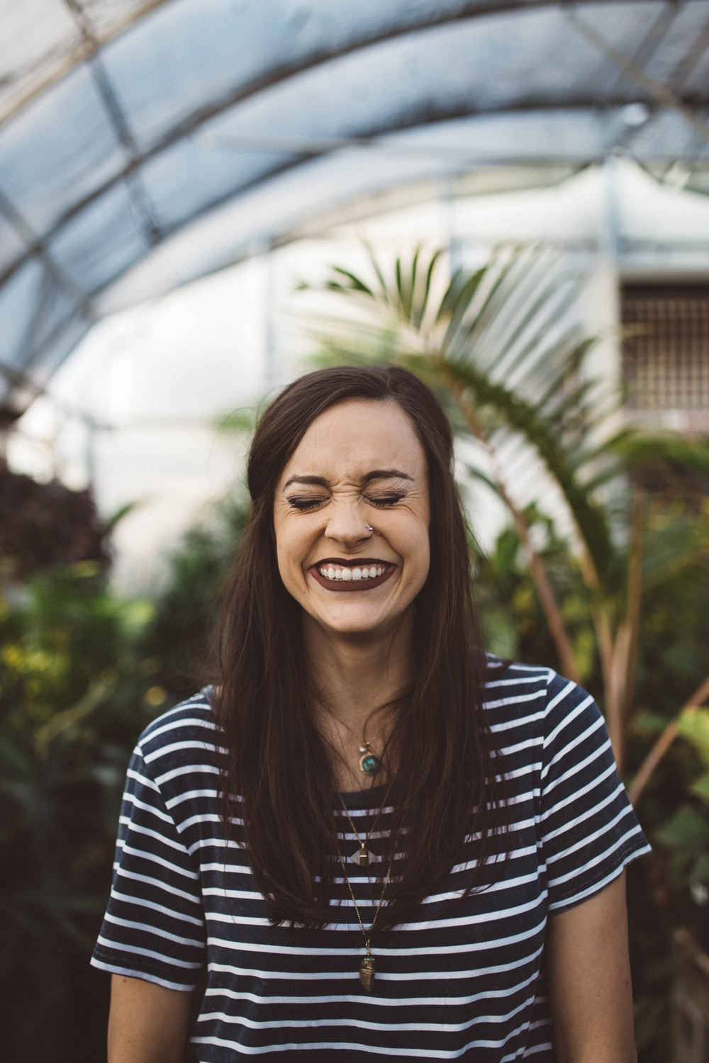 woman smiling while standing in garden
