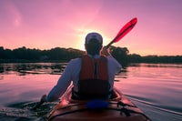 man riding on kayak