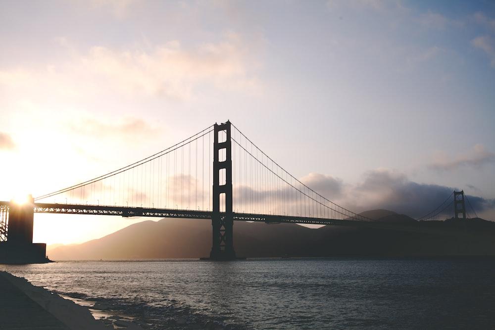 concrete bridge during golden hour