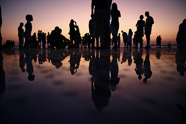 #RaiseTheGameJam. silhouette of people standing on mirror during golden hour