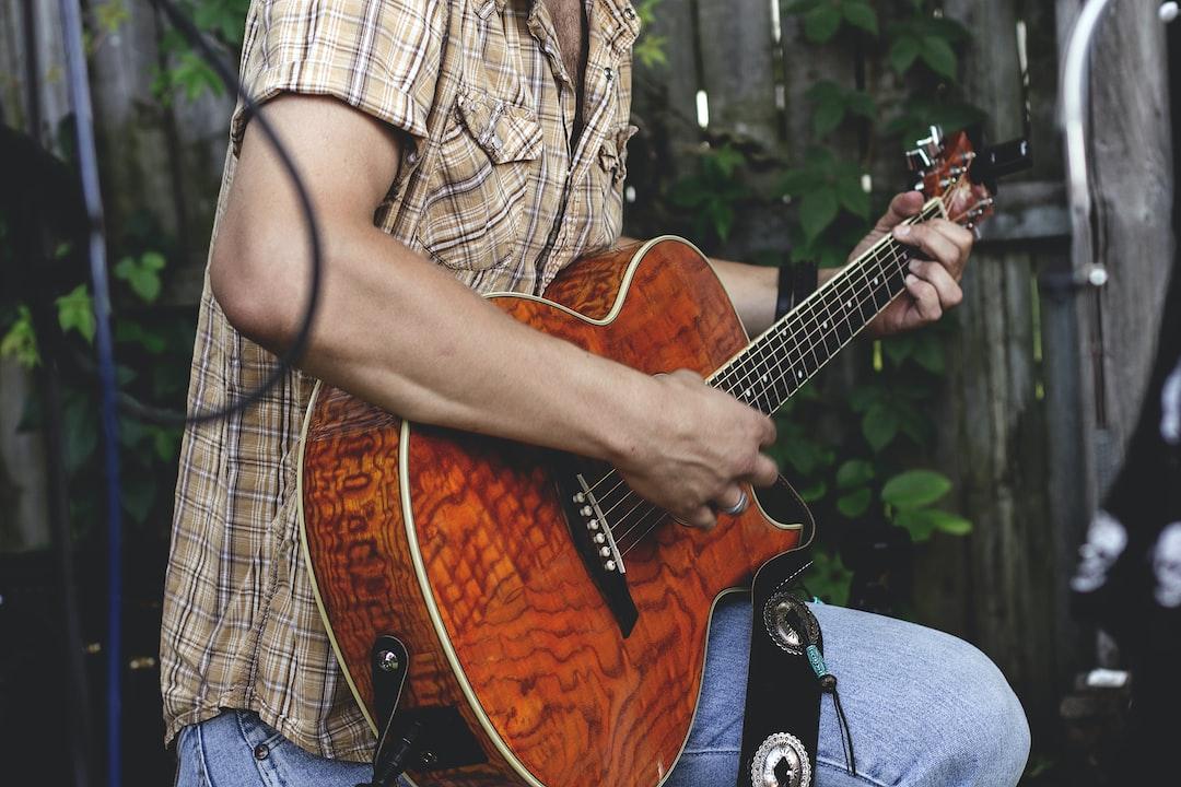 Guitar player in a garden