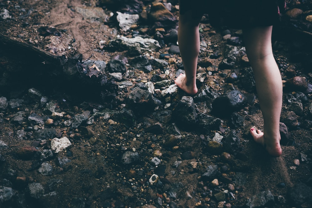 person walking on rocky grounds