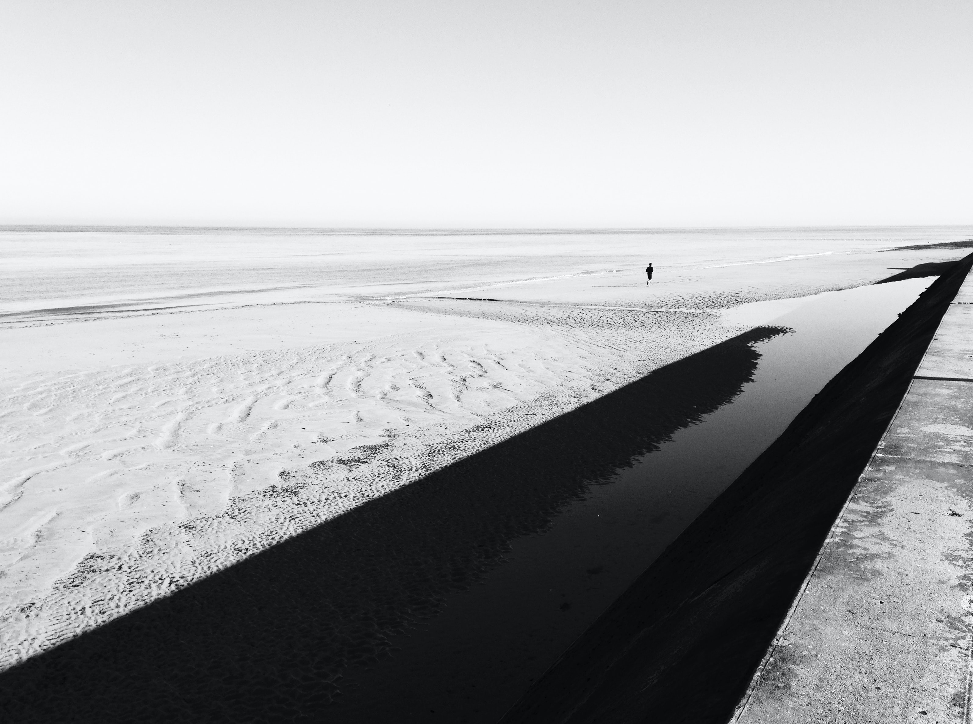 person walking on snow during daytime