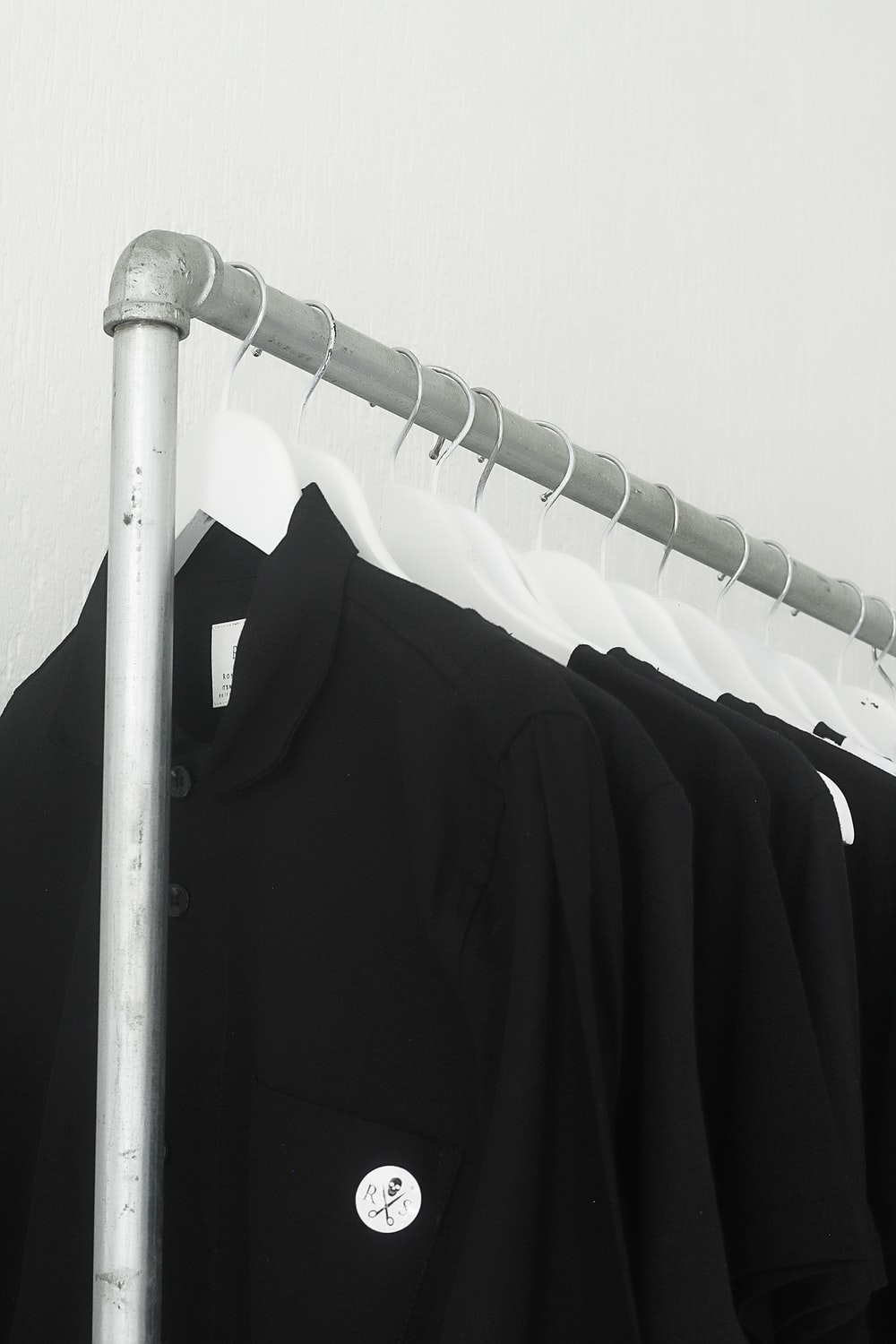 black blazer on white clothes hanger