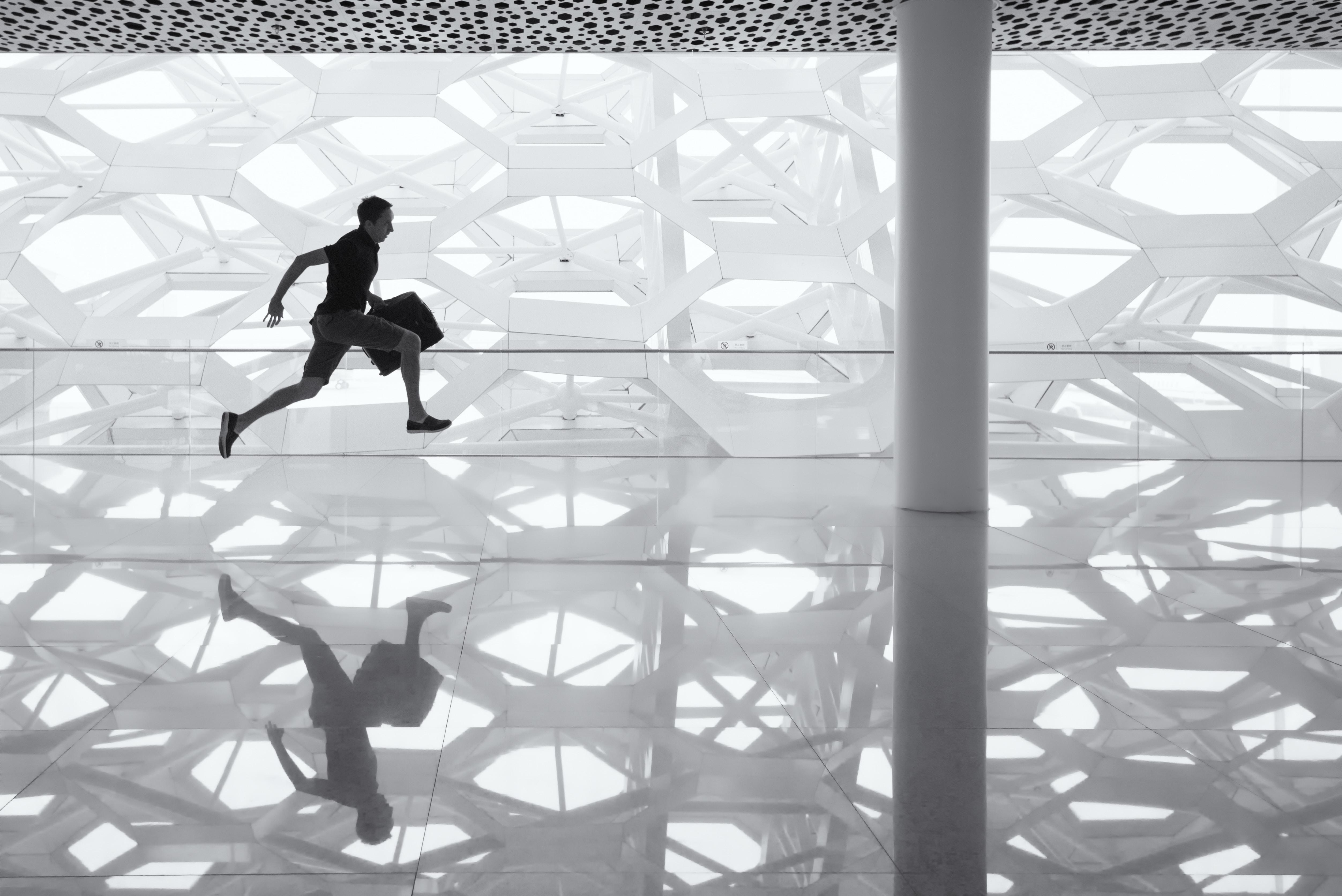 A man running with a briefcase at Shenzhen Bao'an International Airport