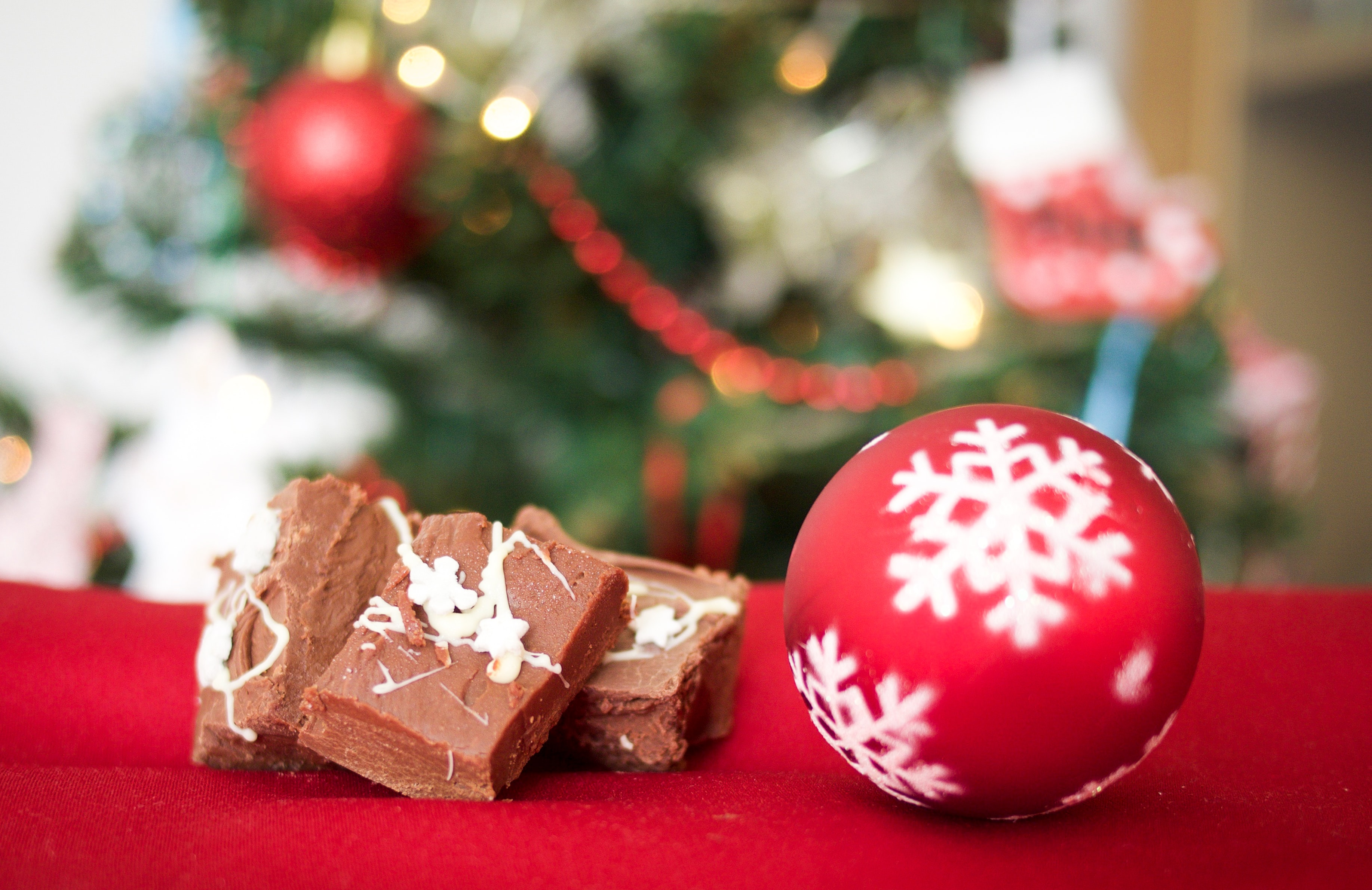 red and white bauble beside chocolates