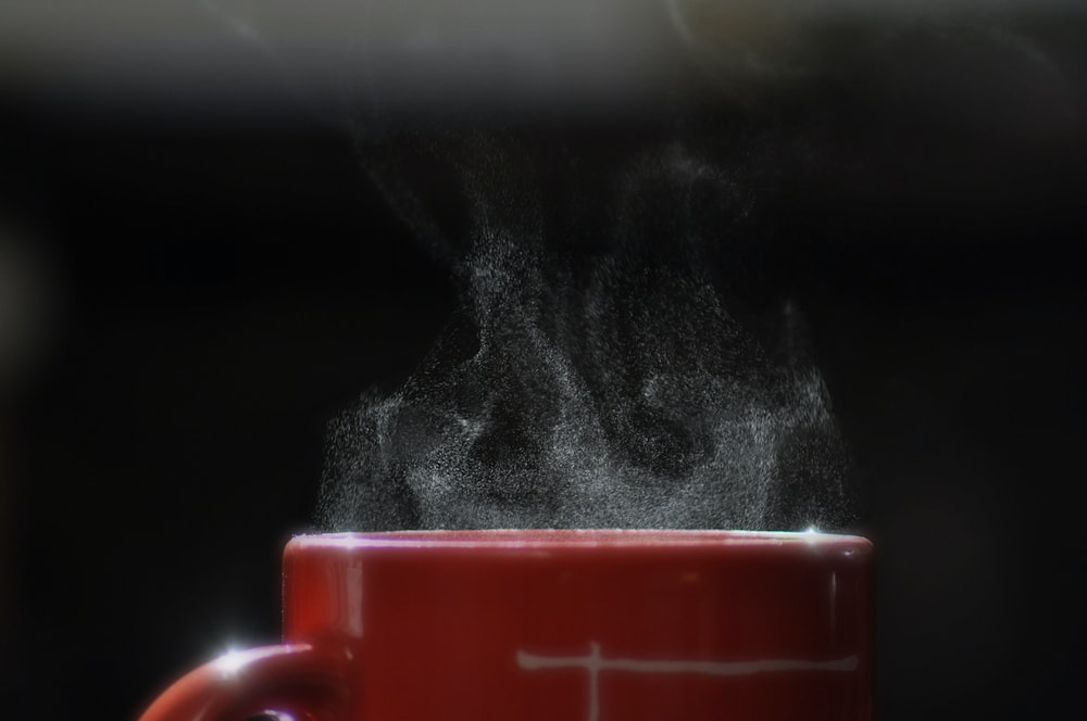 smoke coming out from mug filled with beverage