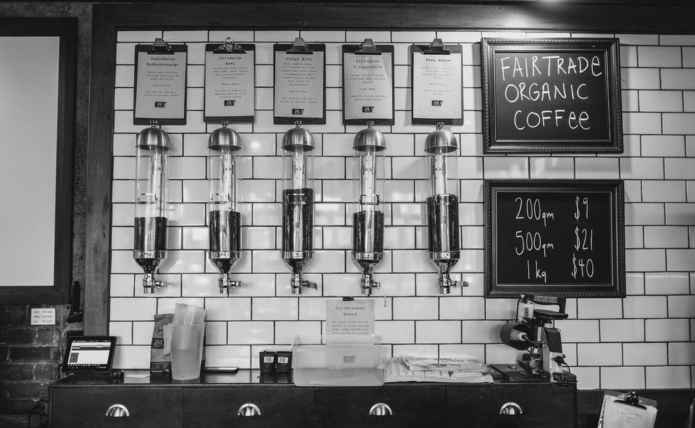 coffee bar with five coffee beans in dispensers on the wall