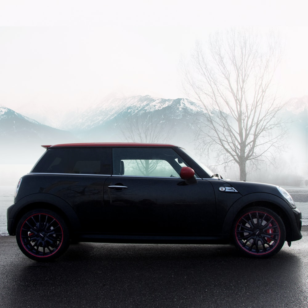 black Mini cooper parked on road
