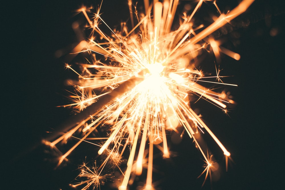 photo of lighted sparkler