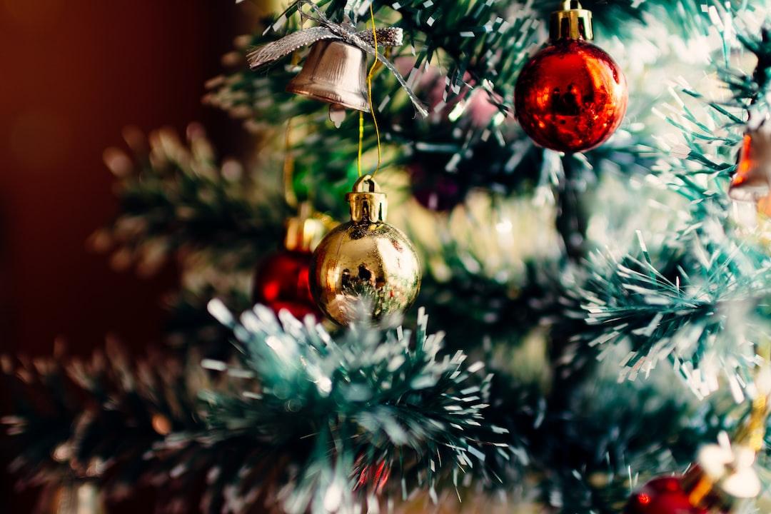 A macro view of a Christmas ornament on a Christmas tree.