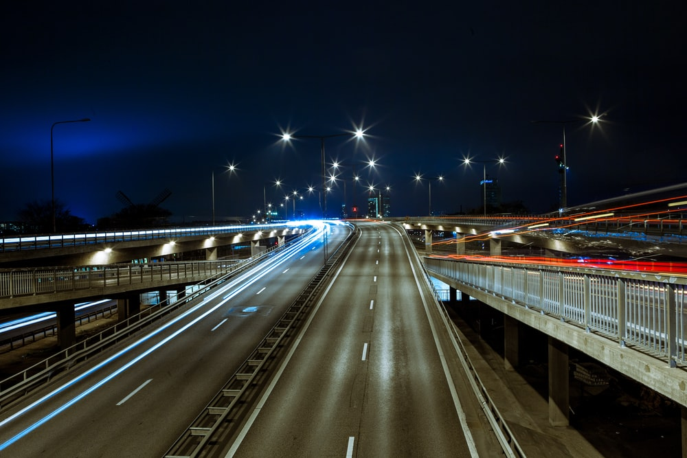 time lapsed photography of concrete curved road