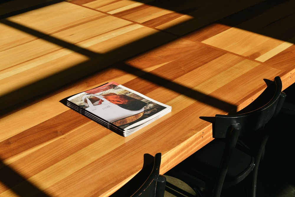white labeled book on brown table