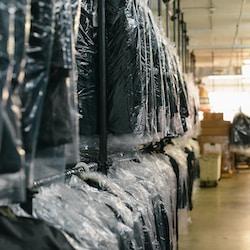 black suit hanging on rack