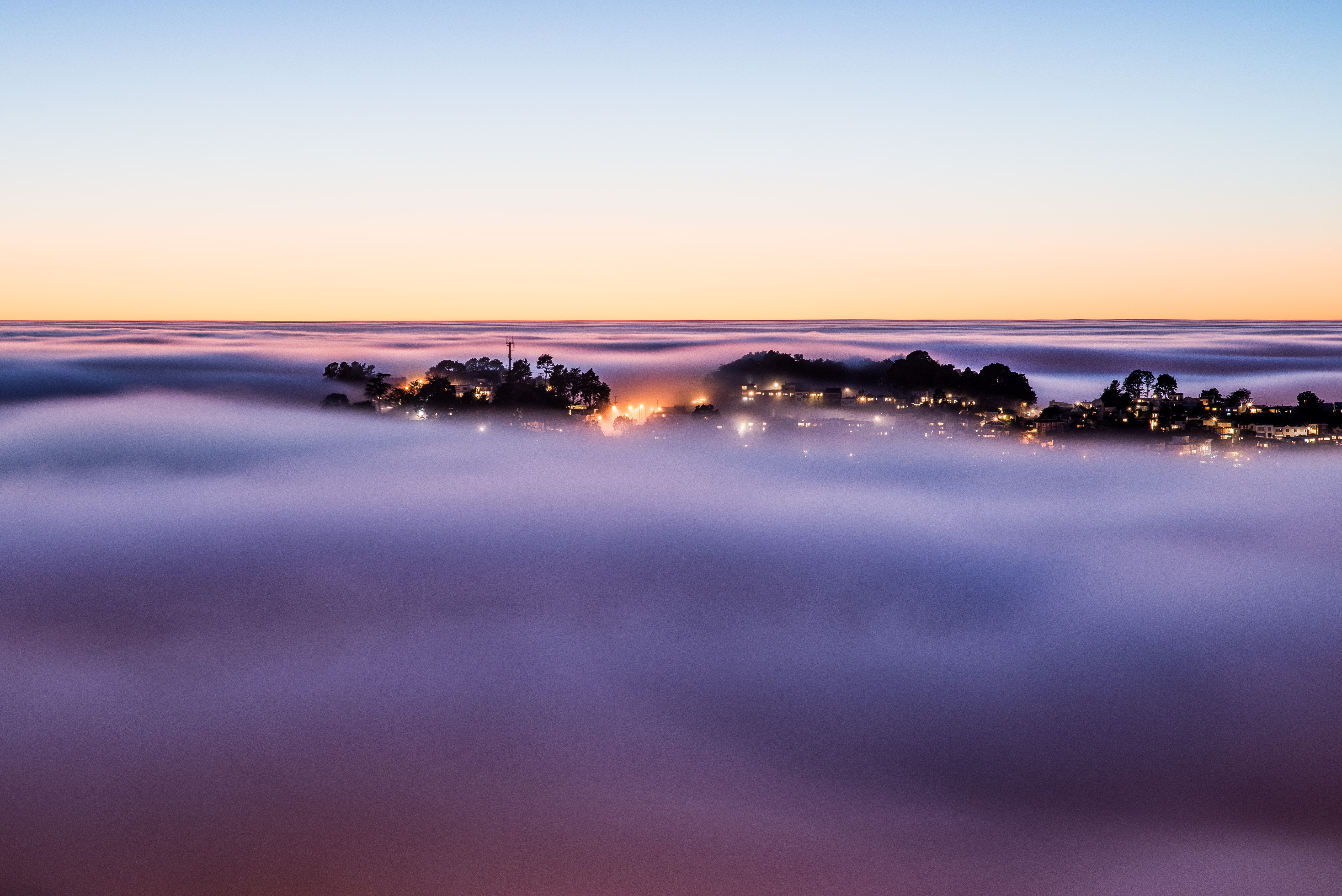 The foggy sunrise over Twin Peaks in San Francisco